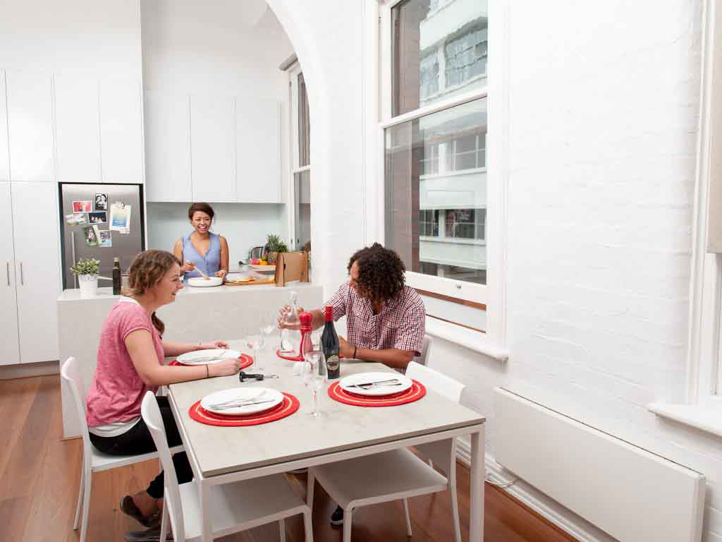 4 smart ways to share your way to a home deposit - flatmates sharing dinner